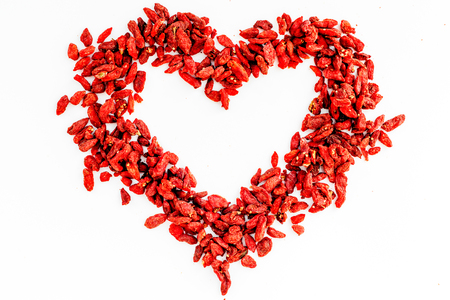 Dried goji berries on white background top view.