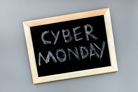 Words cyber monday written on blackboard on grey background top view. Stock Photo