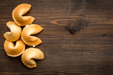 Prediction in fortune cookie on wooden table background flat lay mockup 版權商用圖片