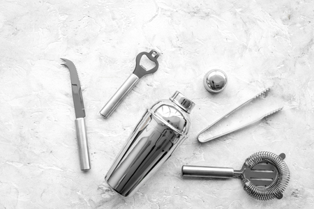 Bar tools for making cocktails on grey stone background top view copyspace Stock Photo