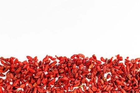 Dried goji berries on white background top view copyspace pattern