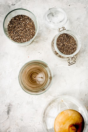 Soak chia seeds in water. Grey background top view Stock Photo