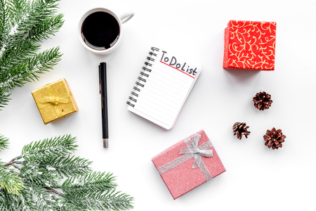 Make to do list for new year. Notebook among new year decorations on white background top view Stock Photo