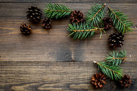 Spruce branch and pinecone pattern on wooden background top view copyspace Stock Photo