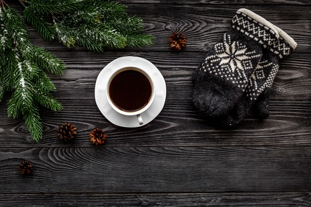 Cozy christmas evening. Knitten mittens and scarf on grey wooden background top view copyspace Stock Photo