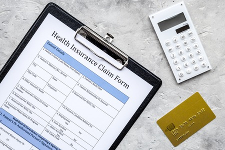 Buy health insurance. Document, bank card and calculator on grey background top view Stock Photo