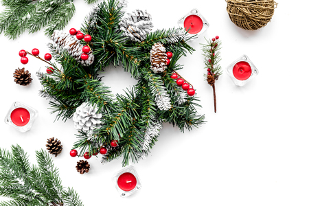 Make christmas wreath. Spruce branches, cones, threads, sciccors on white background top view copyspace Stock Photo