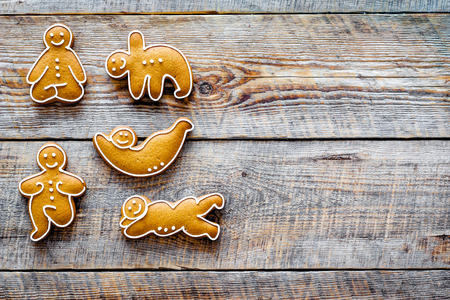 Gingerbread cookies in shape of yoga asanas on wooden top view copyspace