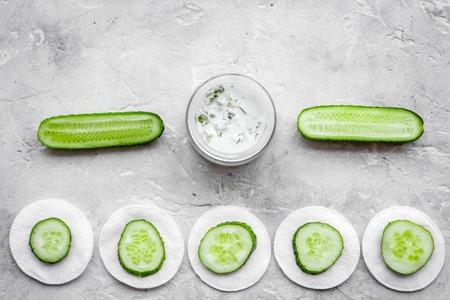 Cucumber moisturizing cream or mask pattern. Grey top view copyspace Stock Photo