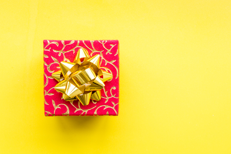 boxing day: Shopping and sales. Red gift box on yellow top view copyspace