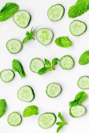 Skin care at home. Sliced cucumber pattern on white top view Stock Photo