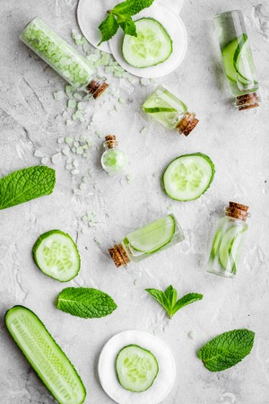 Lotion with cucumber pattern. Grey top view Stock Photo
