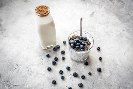 How to eat chia seeds. Dessert with yogurt, chia and blueberries on grey