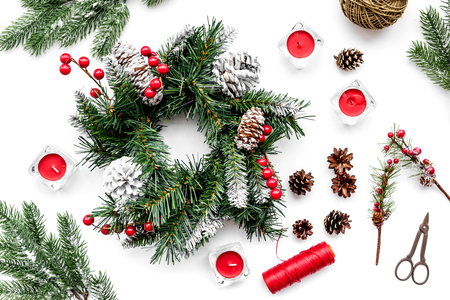 Make christmas wreath. Spruce branches, cones, threads, sciccors on white top view Reklamní fotografie