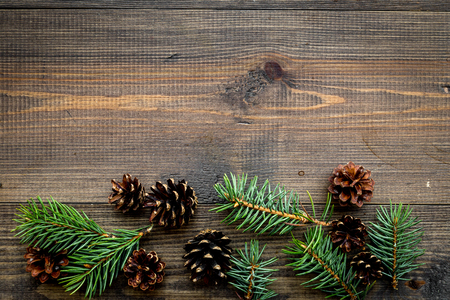 Spruce branch and pinecone pattern on wooden top view copyspace Stock Photo