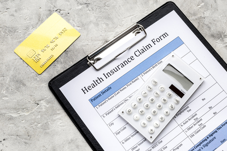 Buy health. Document, bank card and calculator on grey top view Stock Photo