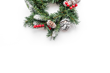 Christmas wreath woven of spruce branches with red berries on white top view copyspace Stock Photo