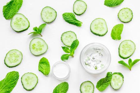 Cucumber moisturising cream or mask pattern. White top view Stock Photo