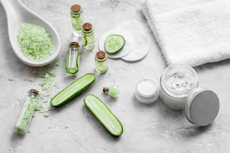 Natural cucumber cosmetics. Lotion, cream, spa salt on white
