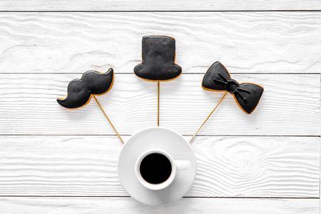 Men birthday concept. Set of cookies in shape of black tie, mustache and hat. White wooden background top view Stock Photo