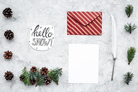 Write greetings. Envelope, paper, pen, hello snow hand lettering on grey background top view pattern