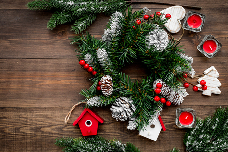 Christmas decorations. Wreath and toys on wooden top view copyspace Stock Photo