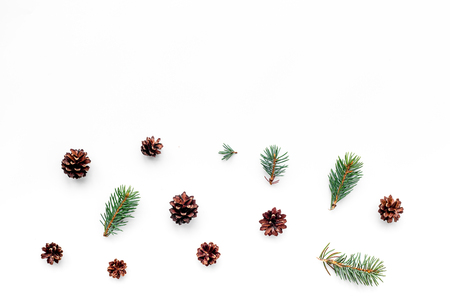 New year symbols pattern. Spruce branches and cones on white top view copyspace Stock Photo