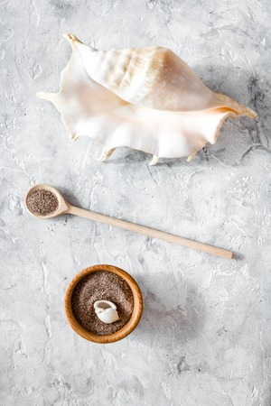 spa cosmetic set with sea salt for bath and shell on stone top view Reklamní fotografie - 89822531