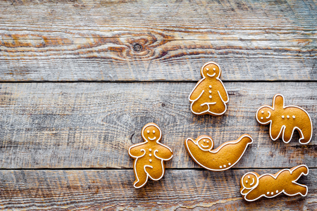 Gingerbread cookies in shape of yoga asanas on wooden  top view copyspace Stock Photo