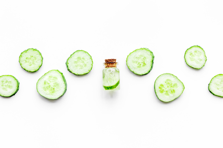 Lotion with cucumber pattern. White background top view copyspace Stock Photo