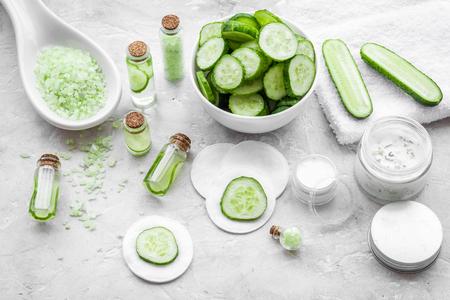Natural cucumber cosmetics. Lotion, cream, spa salt on white background Stock Photo