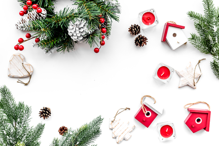 Christmas decorations. Wreath and toys on white background top view.