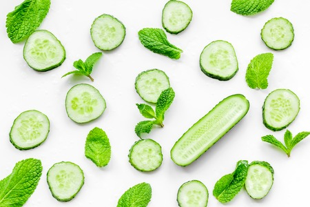 Skin care at home. Sliced cucumber pattern on white background top view.