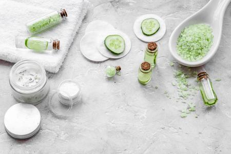 Natural organic cucumber cosmetics on white background.