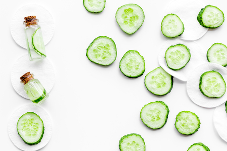 Lotion with cucumber pattern. White background top view. Stock Photo