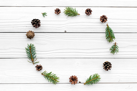 New year symbols pattern. Spruce branches and cones on white wooden background top view. Stock fotó