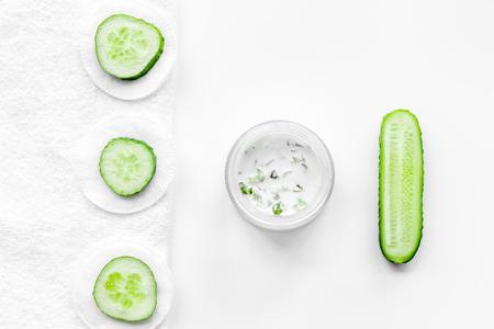 Cucumber moisturising cream or mask. White background top view.
