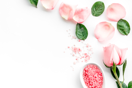 Pattern with rose oil cosmetics. Rose petals, spa salt on white background top view. Zdjęcie Seryjne - 89306088