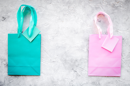 Colored paper shopping bags pattern on grey background top view copyspace Stock Photo