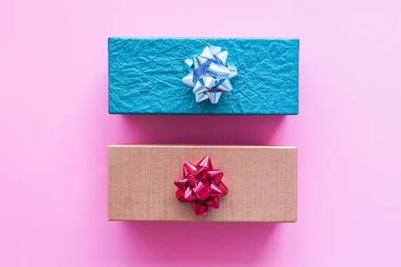 Shopping and sales. Gift boxes on pink background top view