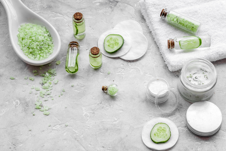 Natural cucumber cosmetics. Lotion, cream, spa salt on white background copyspace Stock Photo