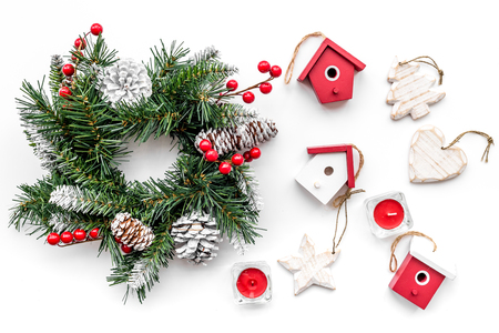 Christmas decorations. Wreath and toys on white background top view