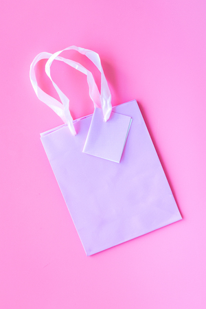 Pink shopping bag on pink background top view mockup copyspace