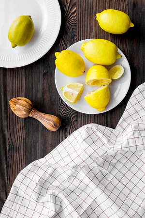 Wooden juicer for making lemonade on dark wooden background top view Stock Photo
