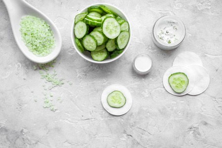 Natural cucumber cosmetics. Lotion, cream, spa salt on white background top view copyspace Stock Photo