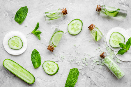 Lotion with cucumber pattern. Grey background top view Stock Photo