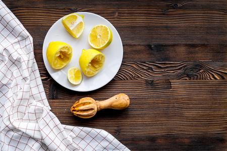 Juicer for making lemonade on dark wooden background top view copyspace Stock Photo