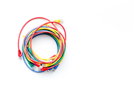 Colored patch-cord in round shape on white background top view copyspace