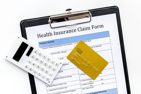 Buy health insurance. Document, bank card and calculator on white background top view Stock Photo
