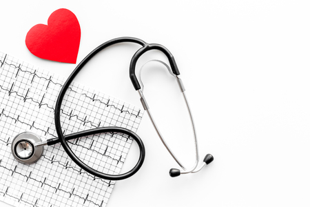 Examine the heart to prevent heart disease. Heart sign, cardiogram, stethoscope on white background top view. Stock Photo
